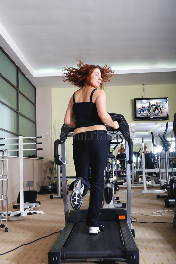 Download Woman running on treadmill stock image. Image of running - 7418241