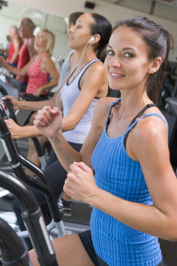 Woman Running On Treadmill At Gym Royalty Free Stock Image