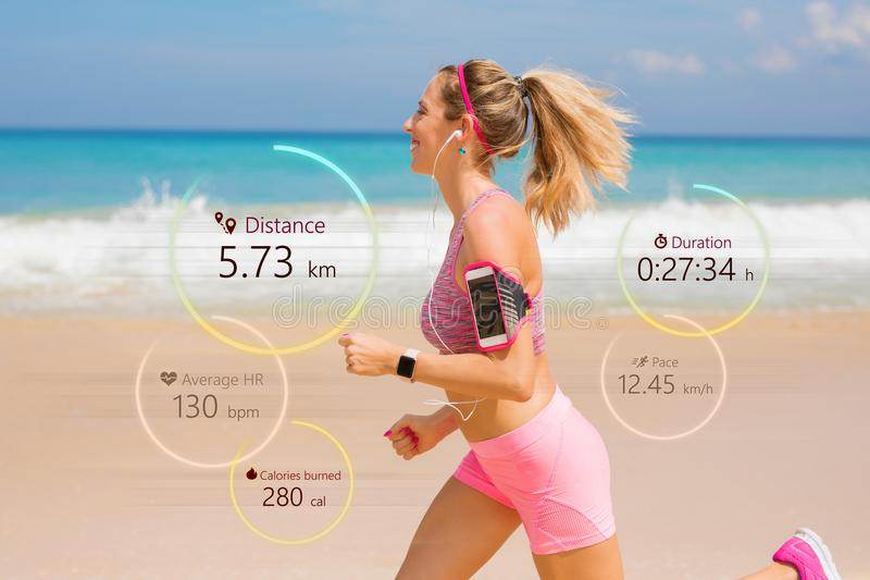 Woman running, wearable tech concept stock photography