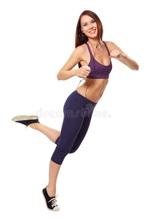 Woman running on white with headphones the phone stock photos