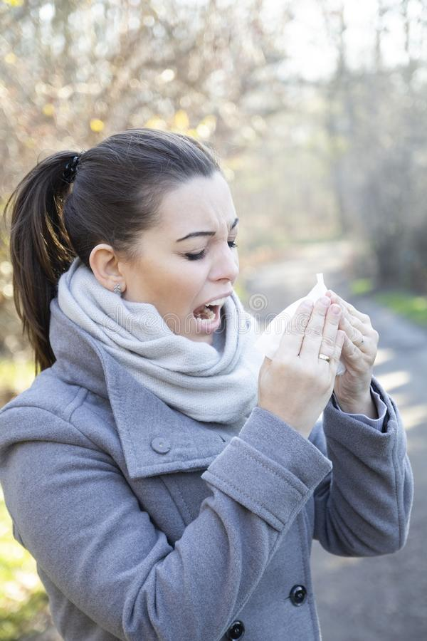 Young beautiful woman allergic in the park stock images