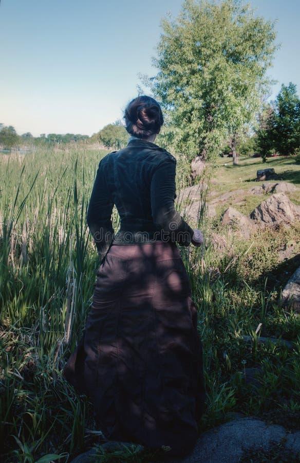 A woman runs along the swamp stock photo