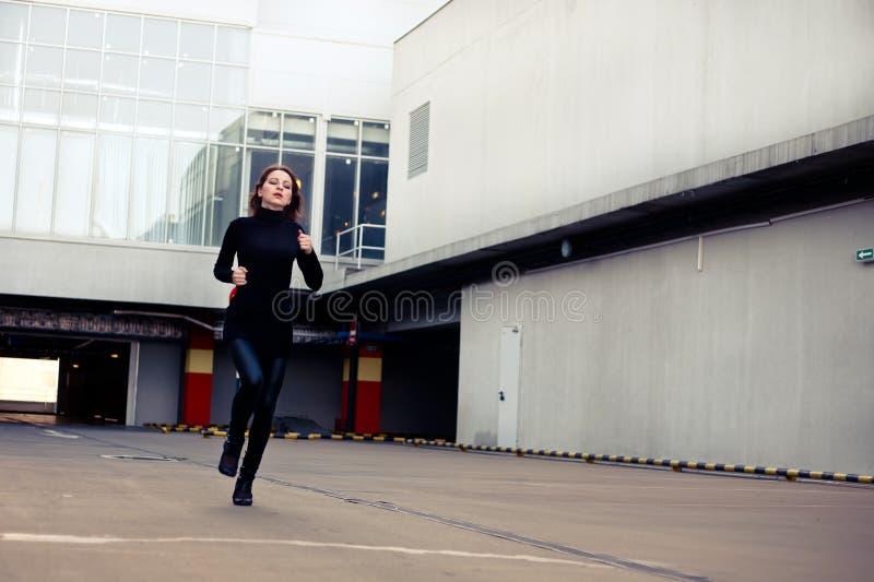 Woman runs away royalty free stock photography