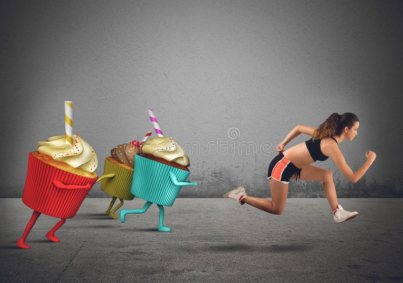 Woman runs away from sweets stock photo