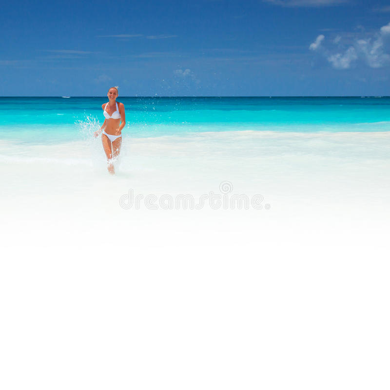 Woman runs out of the sea royalty free stock photos