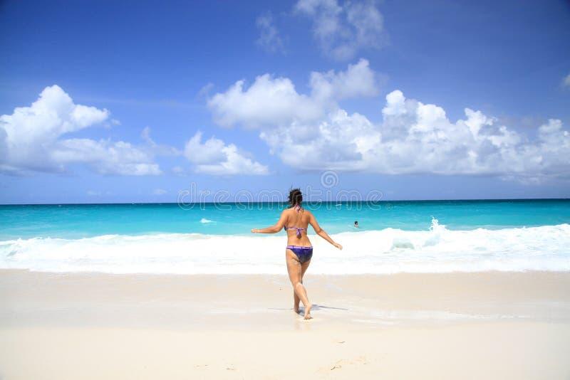 Woman runs towards the sea royalty free stock photos