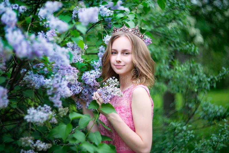 Woman, russian model in bloom spring lilac park royalty free stock photos