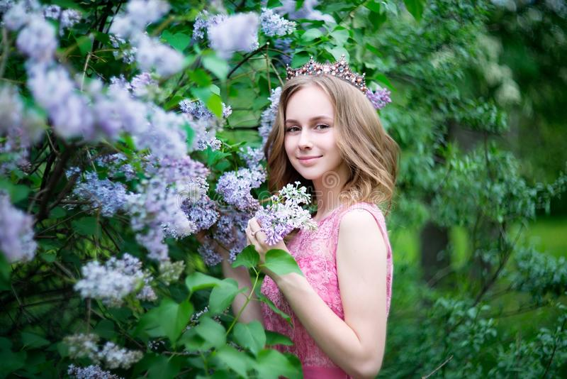 Woman, russian model in bloom spring lilac park royalty free stock photo