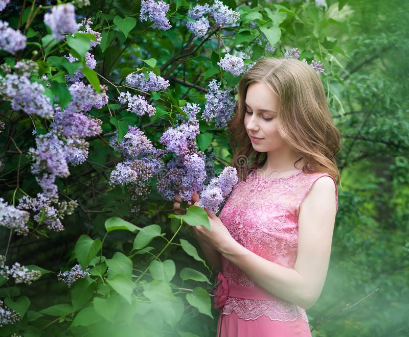 Woman, russian model in blossom spring lilac park. Woman, russian model in spring lilac park stock photos
