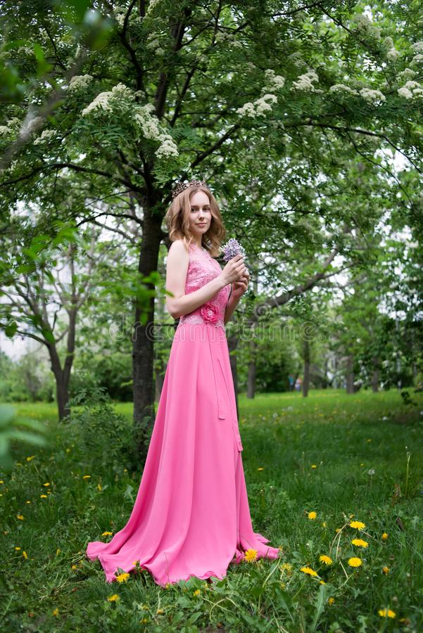 Woman, russian model in blossom spring lilac park royalty free stock image