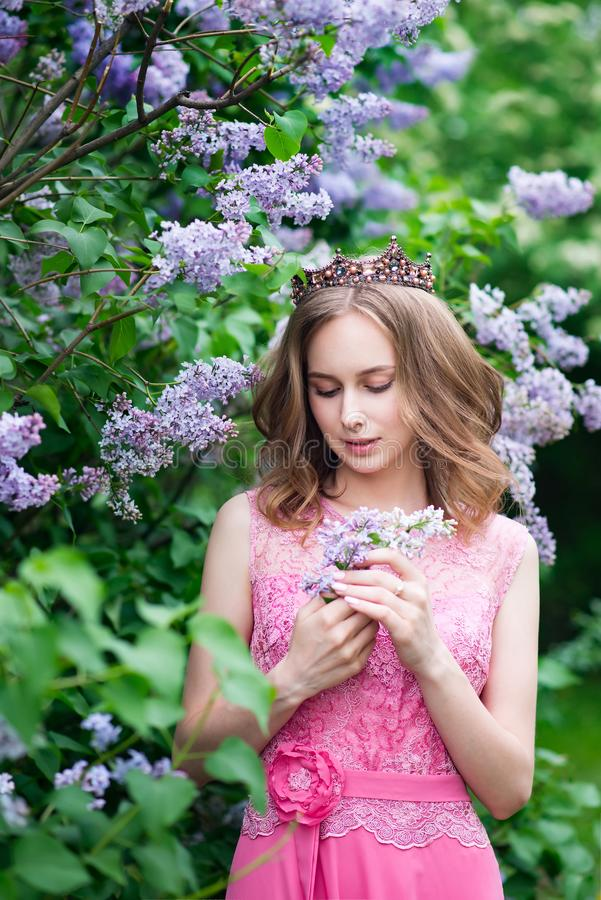 Woman, russian model in blossom spring lilac park royalty free stock photo