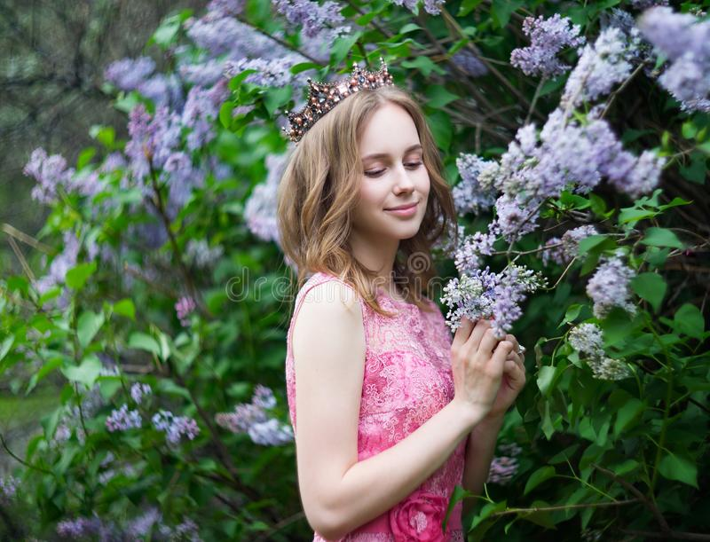 Woman, russian model in spring blossom lilac park. Woman, russian model in spring lilac park stock photography
