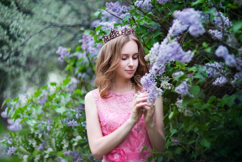 Woman, russian model in spring blossom lilac park. Woman, russian model in spring lilac park stock image