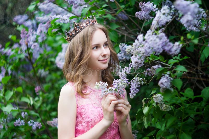 Woman, russian model in spring blossom lilac park royalty free stock photo