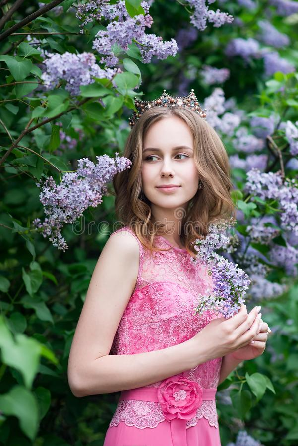 Woman, russian model in blossom spring lilac park royalty free stock photos