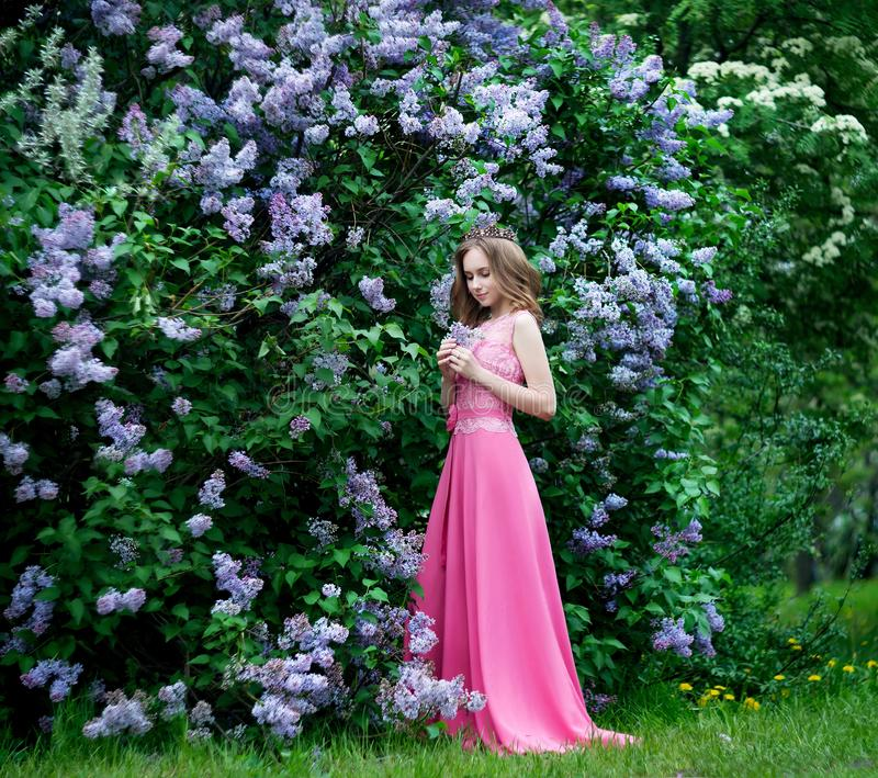 Woman, russian model in blossom spring lilac park royalty free stock photography