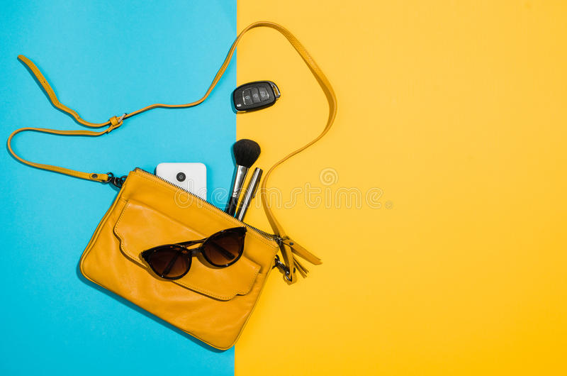 Woman`s accessories flat lay on colorful background top view. Woman`s accessories flat lay on colorful background. Top view Blue and yellow pastel colors with stock photo