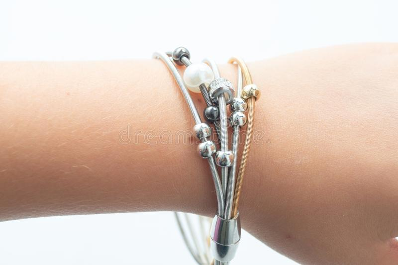Woman`s arm with bracelet on white background royalty free stock image