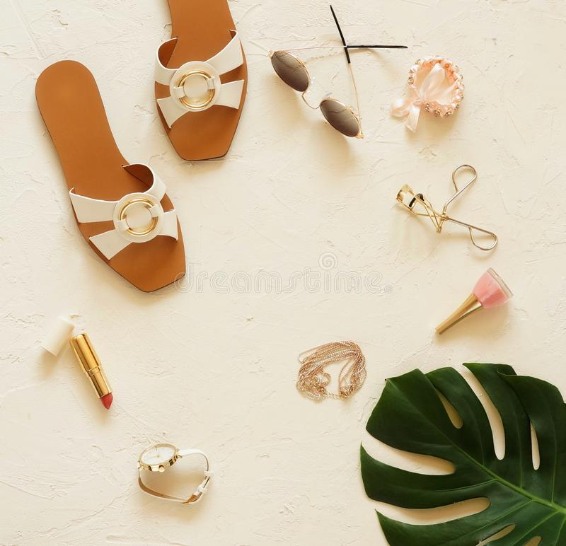 Woman`s beach accessories fashion top view background stock photos