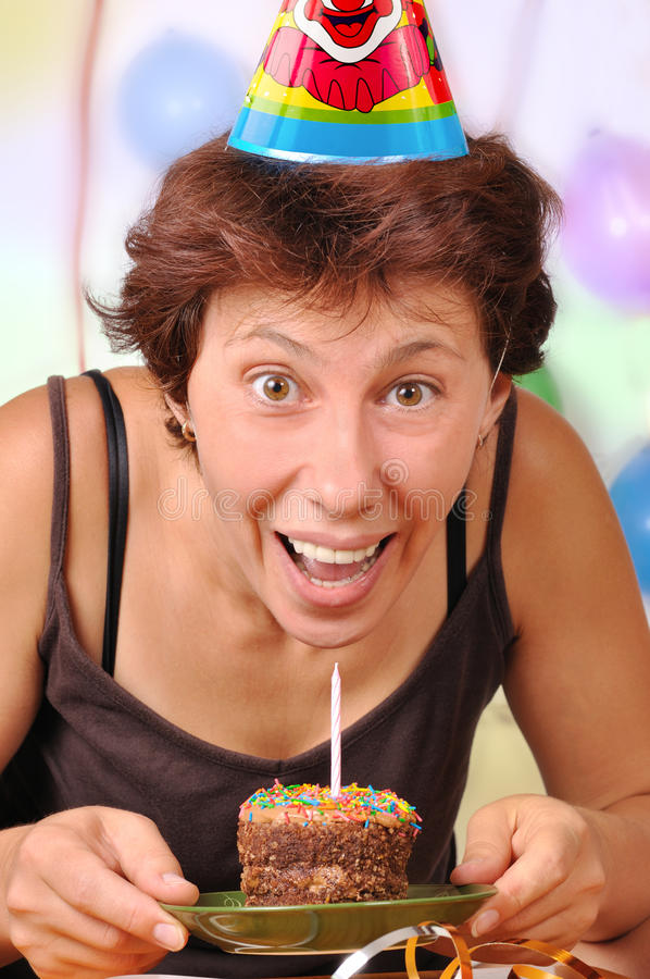 Woman's birthday. Woman with a cake and candles on his birthday royalty free stock image
