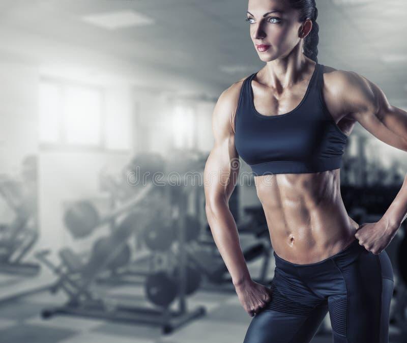Woman's body bodybuilder royalty free stock photography