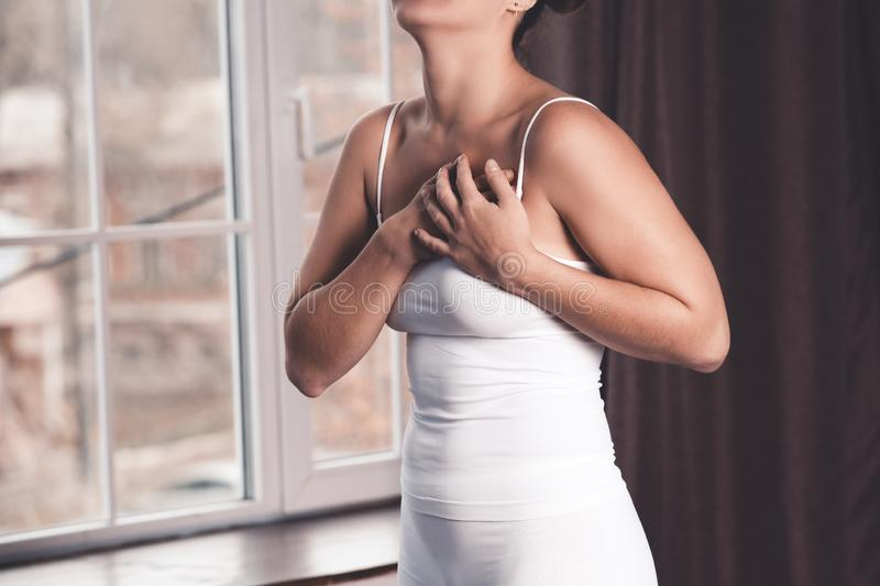 Woman`s breast test, heart attack, pain in human body stock photo