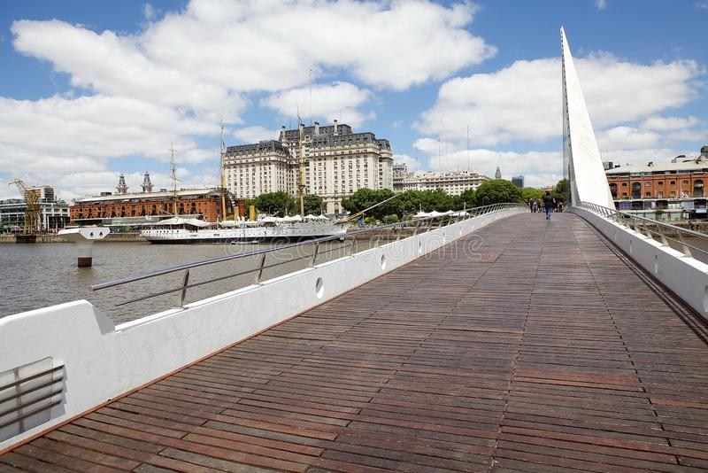 Woman`s Bridge by Santiago Calatrava in Puerto Madero in Buenos Aires, Argentina. Panorama of Puerto Madero in Buenos Aires, Argentina with new buildings and stock photography
