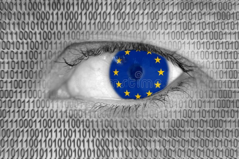 Woman's eye with flag of EU European Union and binary code numbers. Data Protection Act in EU European Union: woman's eye with flag of EU European Union and stock photos