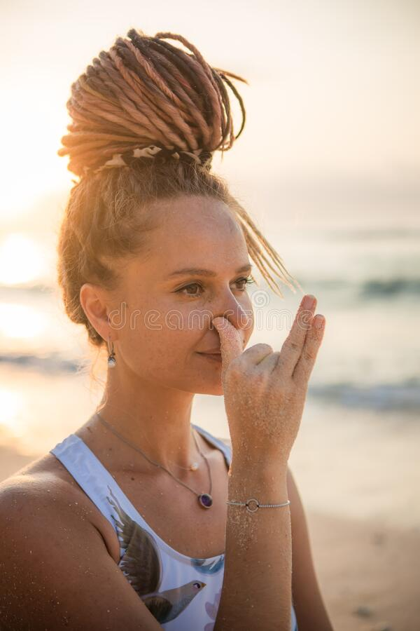 Free Woman`s Face Close Up. Yogi Woman Practicing Anuloma Viloma Pranayama, Alternate Nostril Breathing. Breathing Exercise. Self Care Royalty Free Stock Images - 208301269