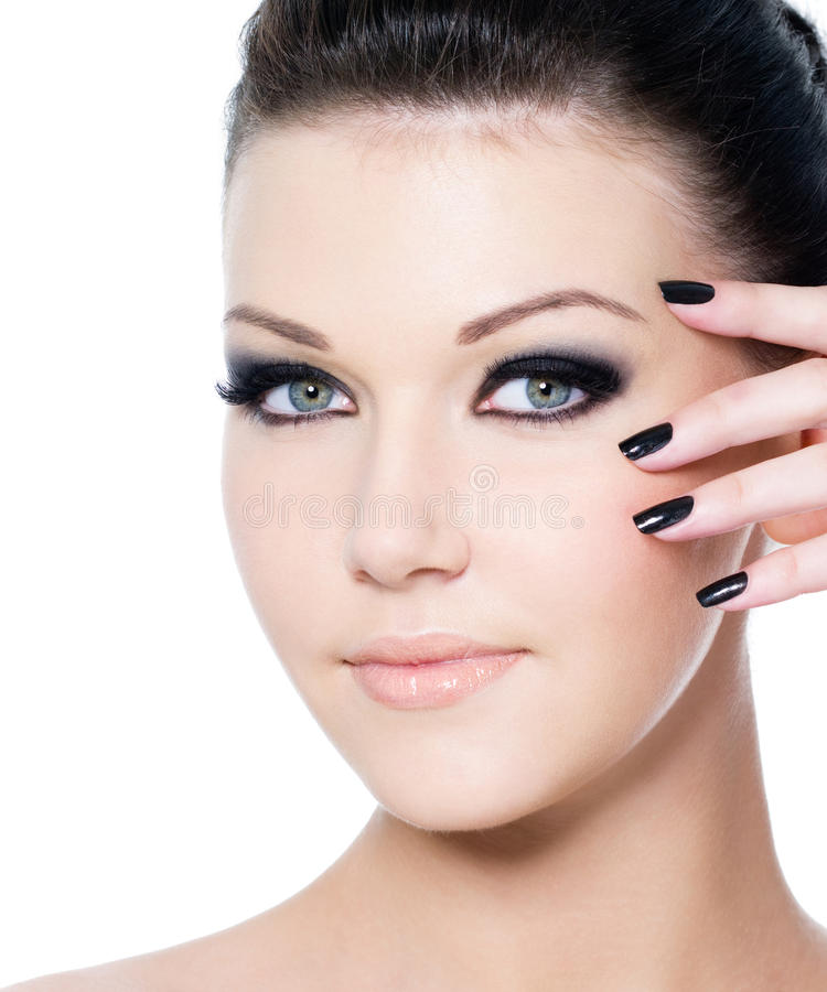 Woman's face with glamour make-up stock image