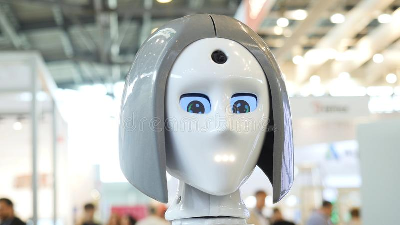 Woman`s face on a high-tech robot. Media. High-tech robot at the exhibition. Robotic of a human like droid robot.  royalty free stock photos