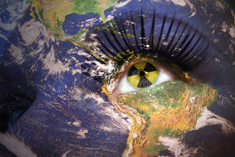 Woman`s face with planet Earth texture and sign of radiation ins stock photos