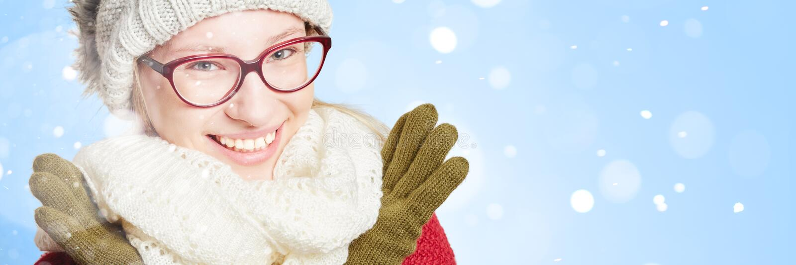 Woman`s face in the snow in winter royalty free stock images