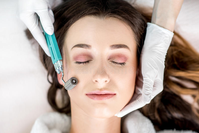 Woman`s facial treatment stock image