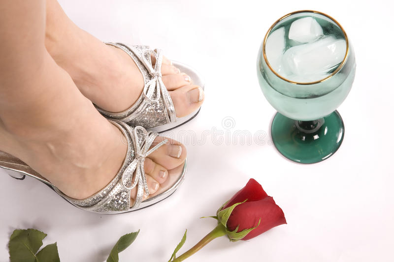 Woman's feet and glass top view royalty free stock images
