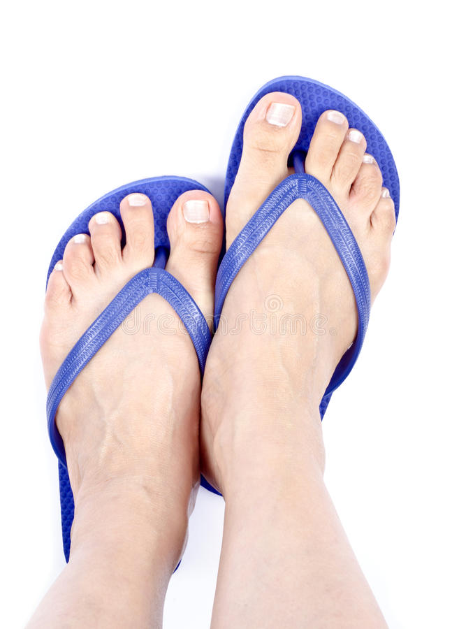 Woman's Feet Wearing Blue Flop Flops. Isolated on White stock photo