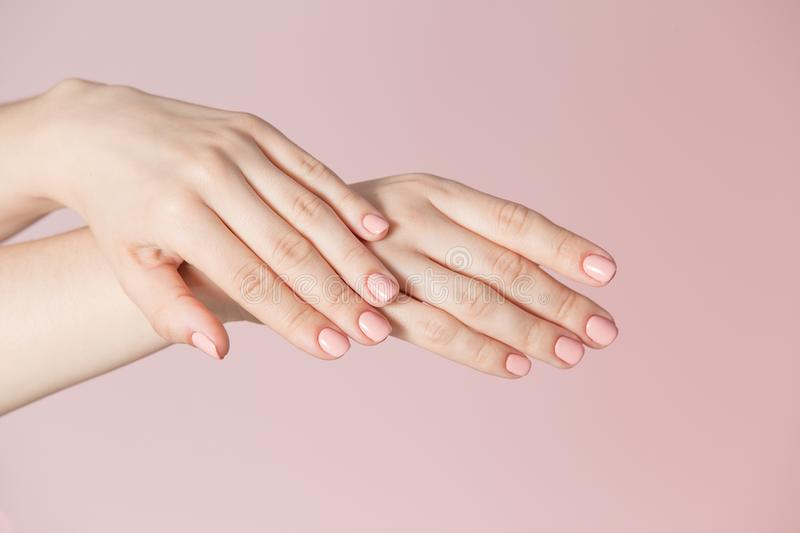Woman`s fingers with pink manicure royalty free stock image