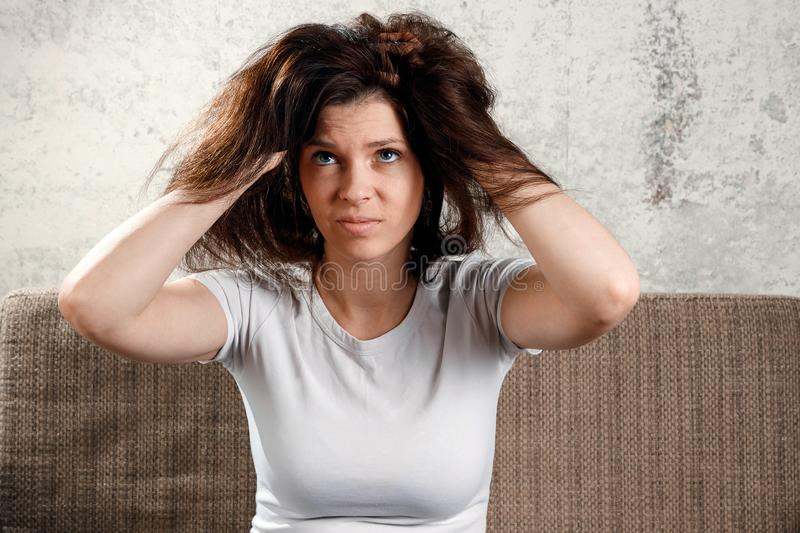 Woman`s hair, woman with disheveled hair.  stock photography