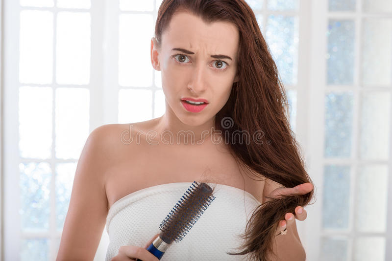 Woman's hair loss stock images