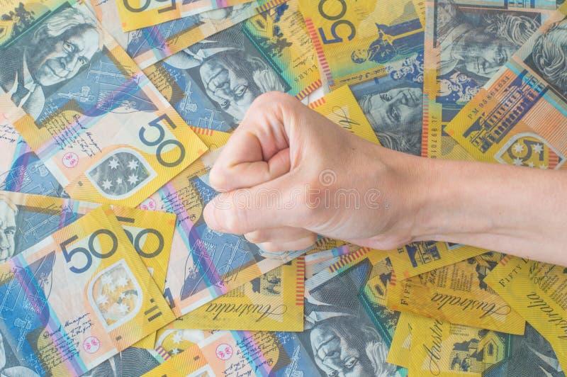 Woman's hand on Australian Dollar. Banknote stock photo