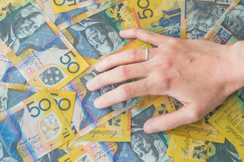 Woman's hand on Australian Dollar. Banknote stock images