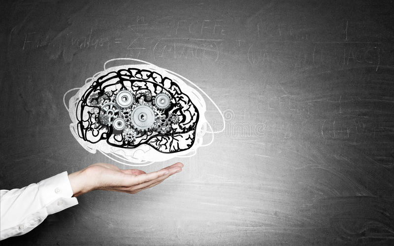 Woman's hand and brain with cogs. Woman's hand holding brain sketch with gears. Blackboard is seen at the background. Concept of intellect and cognitive royalty free stock photos
