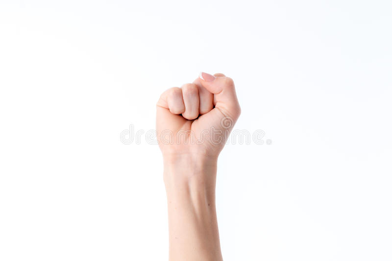 Woman`s hand with a clenched fist fingers isolated on white background stock photography