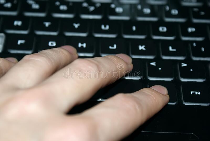 A woman's hand on a computer keyboard. working in the office at the computer. royalty free stock image