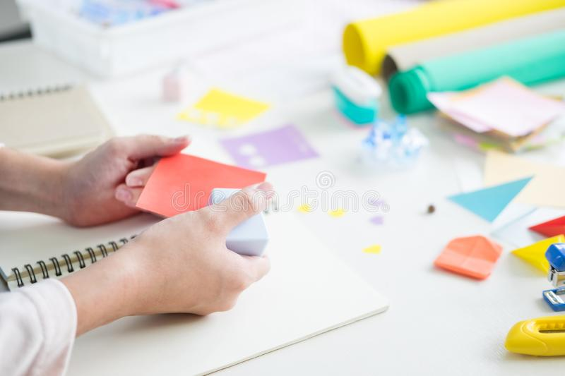 Woman`s hand cut paper Making a scrap booking or other festive decorations DIY accessories arrangement. Woman hand cut paper Making a scrap booking or other royalty free stock photo