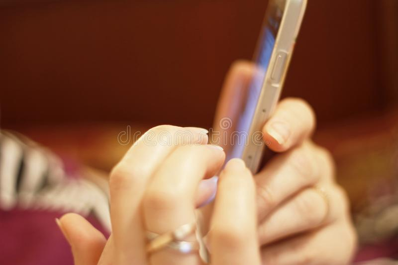 Woman`s hand hold smartphone and touch a screen royalty free stock photos