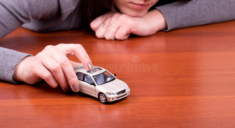 Woman's hand holding car stock image