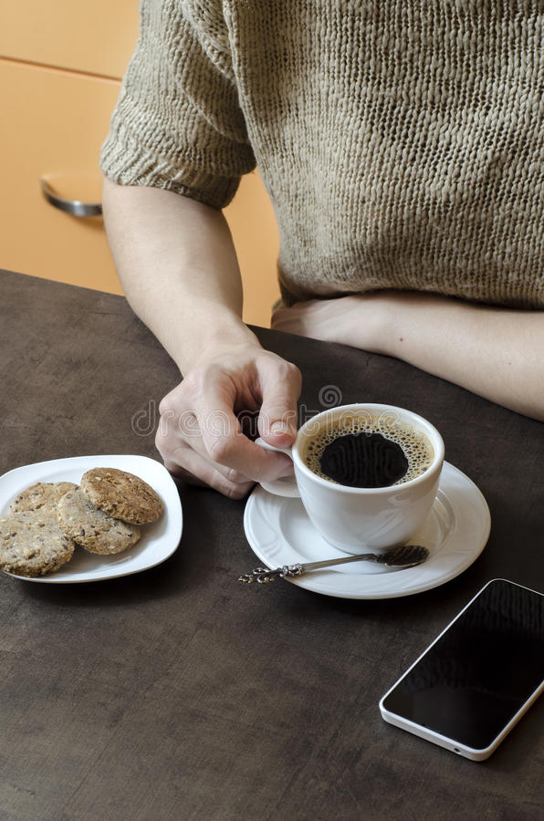 Woman's hand holding a cup of coffee stock images