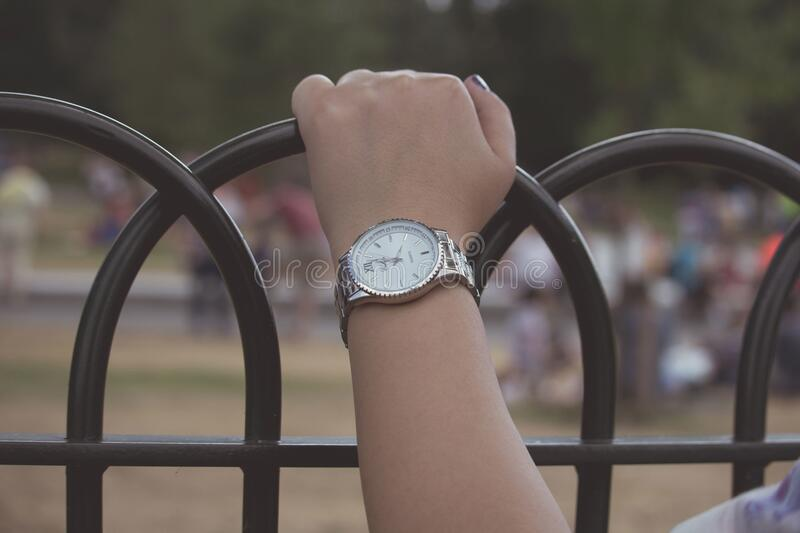 Woman's hand holding railings royalty free stock photography