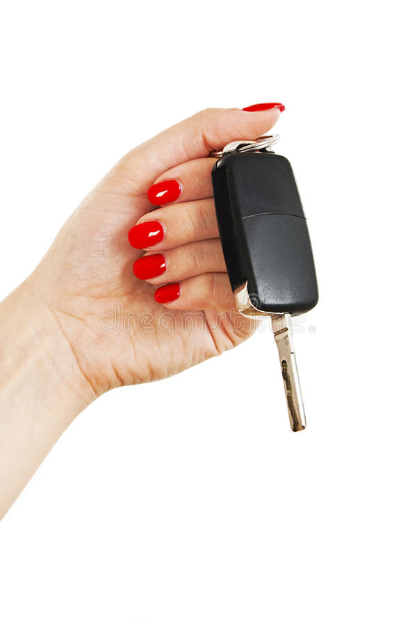 A woman's hand holds car keys. Isolated on white background royalty free stock image